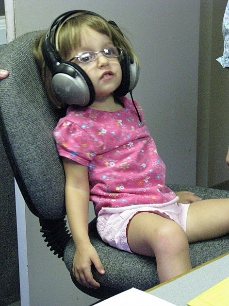 Miracle Child Evelyn just chillin' at the chilrens miracle network radiothon