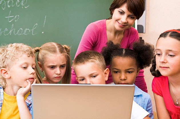 Elementary Students Gathered around a computer - Credit- iStock - 118304405