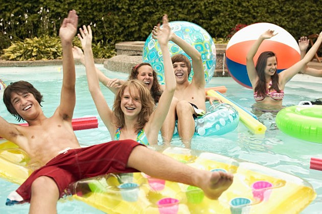 Teenagers in swimming pool