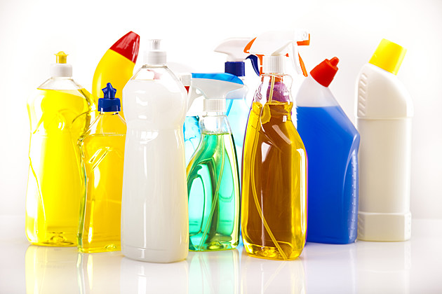 Bottles of cleaning fluids on a white surface