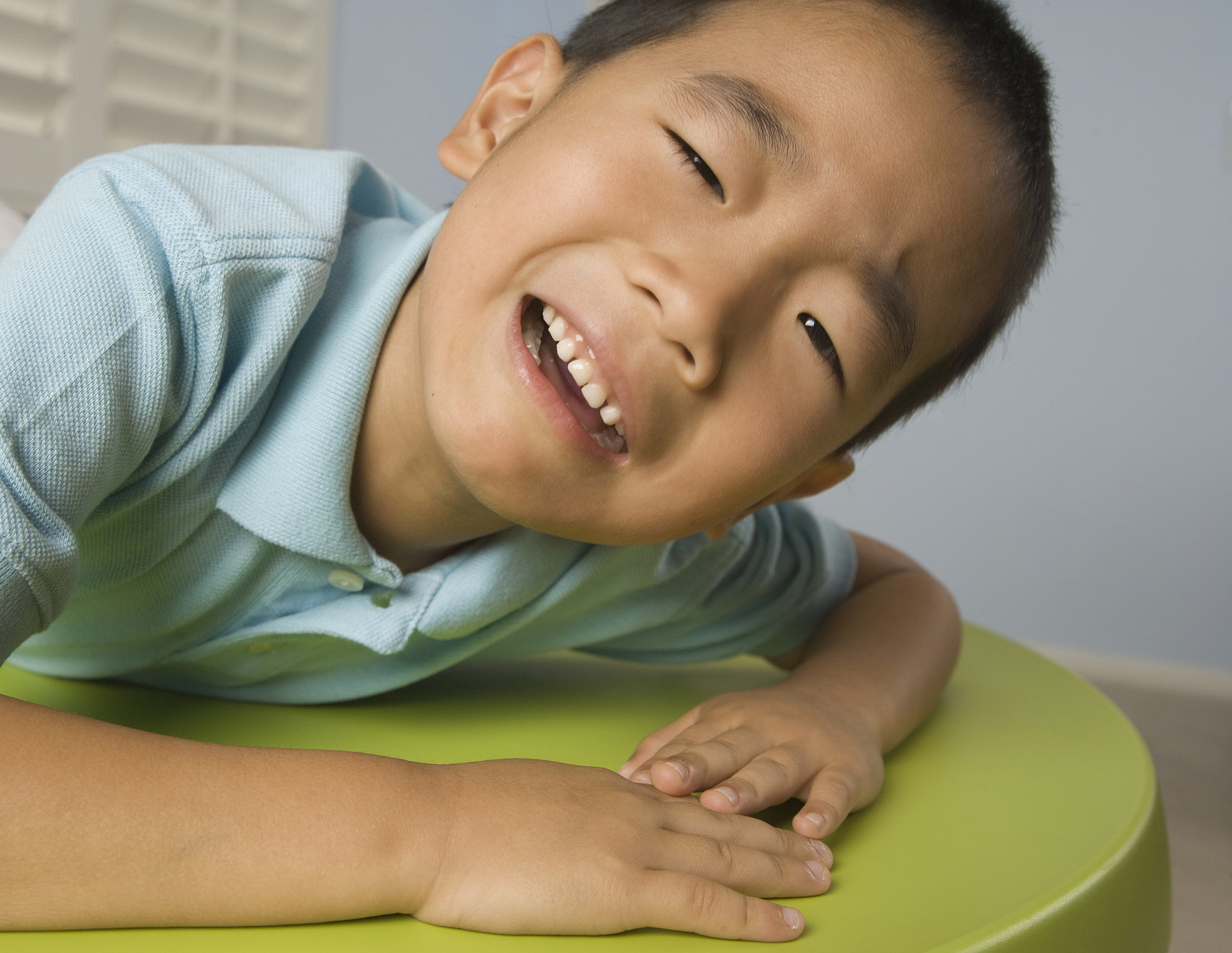 Asian boy crying on table